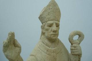 Restauratie aan St. Ambrosius beeld